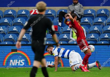 Ryan Manning of QPR falls to the ground after a challenge by Anthony Knockaert of Fulham