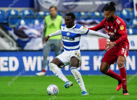 Bright Osayi-Samuel of QPR pushes Michael Hector of Fulham away