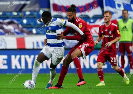 Michael Hector of Fulham challenges Bright Osayi-Samuel of QPR