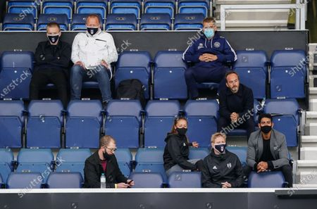 Fulham and QPR staff watch the game whilst staying social distanced