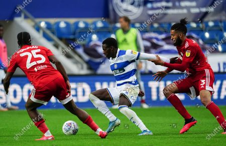 Bright Osayi-Samuel of QPR is challenged by Michael Hector of Fulham and Josh Onomah of Fulham