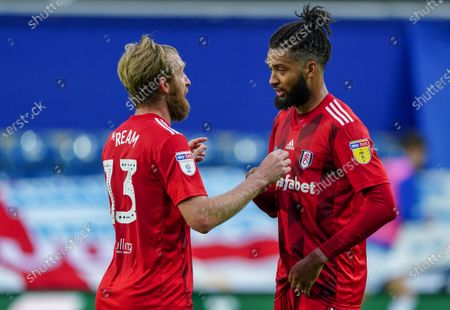Tim Ream of Fulham talks to Michael Hector of Fulham