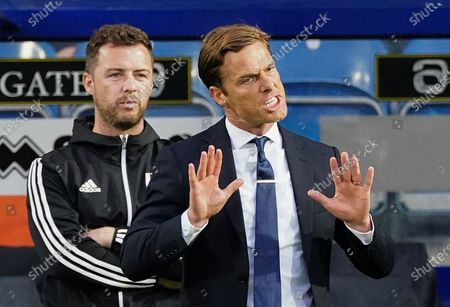 Scott Parker Manager of Fulham reacts to his players alongside Matt Wells First Team Coach