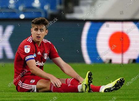 Tom Cairney of Fulham sits on the ground