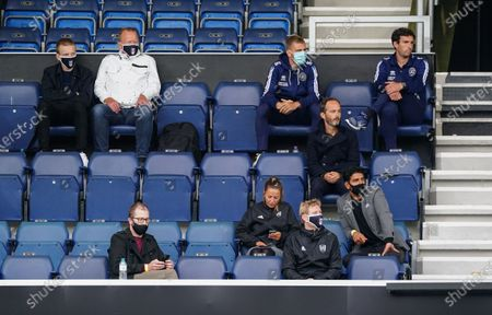 Fulham and QPR staff watch the game whilst staying socially distanced