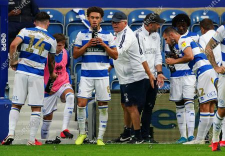 QPR players drinking from IPRO water bottles