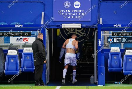 Dominic Ball of QPR runs through the players tunnel shirtless