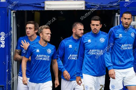 QPR players walk out on to the pitch before kick-off