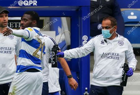 QPR assistant hands out an IPRO water bottle to Bright Osayi-Samuel of QPR