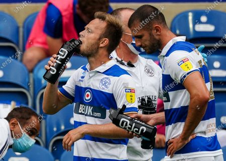 Todd Kane of QPR and Dominic Ball of QPR drinking from IPRO water bottles