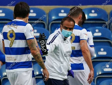 QPR assistant handing out IPRO water bottles during a break in play