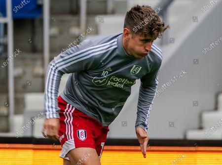 Tom Cairney of Fulham warms up for his 200th game