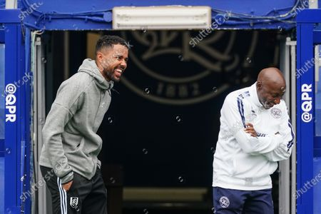 Jordan Archer third choice goalkeeper of Fulham talking with Chris Ramsey Head of Coaching at QPR on the sideline before kick-off