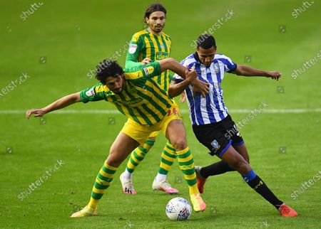 Ahmed Hegazi of West Bromwich Albion battles with Alessio Da Cruz of Sheffield Wednesday
