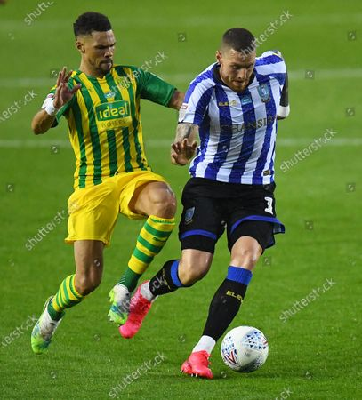 Connor Wickham of Sheffield Wednesday is tackled by Kieran Gibbs of West Bromwich Albion