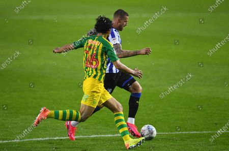 Connor Wickham of Sheffield Wednesday is marked by Ahmed Hegazi of West Bromwich Albion