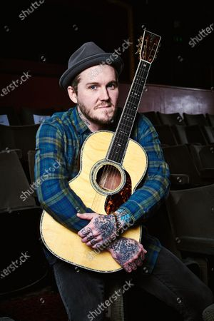 Stock Photo of Portrait of American rock musician Brian Fallon, photographed before a live performance at Komedia in Bath, England, on February 24, 2019. Fallon is best known as a member of The Gaslight Anthem and The Horrible Crowes.