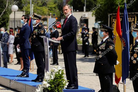 Stock Image of Spain's King Felipe VI (2-R) deliver a speech as he chairs the graduation ceremony of police cadets in Madrid, Spain, 30 June 2020.
