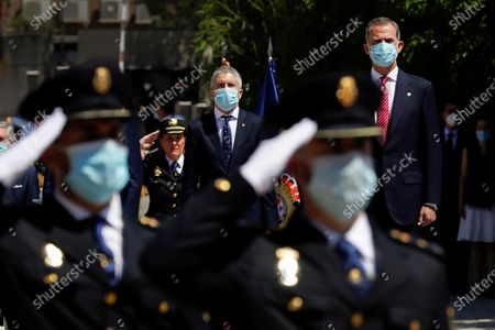 Stock Picture of Spain's King Felipe VI (R) and Spanish Home Minister, Fernando Grande-Marlaska (C) review the police officers as he chairs the graduation ceremony of new cadets in Madrid, Spain, 30 June 2020.