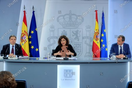 Spanish Treasure Minister and Government's spokeswoman, Maria Jesus Montero (C); Science Minister, Pedro Duque, and Agriculture Minister, Luis Planas (L), address a press conference after the weekly Cabinet Meeting in Moncloa Palace, Madrid, Spain, 30 June 2020.