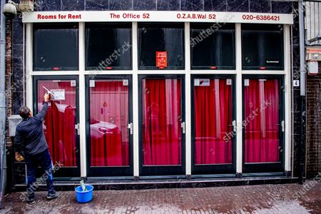 Stock Image of The world famous Red Light District prepares to re-open.