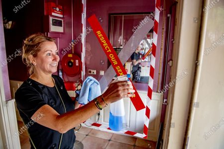 The world famous Red Light District prepares to re-open.