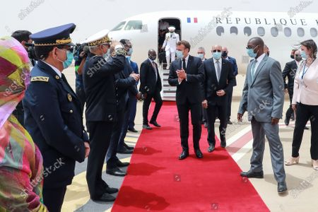 French President Emmanuel Macron (C) is welcomed by Mauritania President Mohamed Ould Ghazouani (2-R) and military officials upon arrival at Nouakchott-Oumtounsy International Airport, in Nouakchott, Mauritania, 30 June 2020, to attend a G5 Sahel summit. The leaders of the G5 Sahel West African countries and their ally France are meeting to confer over their troubled efforts to stem a jihadist offensive unfolding in the region, six months after rebooting their campaign in Pau, southwestern France.