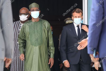 Burkinabe President Roch Marc Christian Kabore (L), Chadian President Idriss Deby (C) and French President Emmanuel Macron (R) wear face masks as they arrive for a group photo during the G5 Sahel Summit in Nouakchott, Mauritania, 30 June 2020. The leaders of the G5 Sahel West African countries and their ally France are meeting to confer over their troubled efforts to stem a jihadist offensive unfolding in the region, six months after rebooting their campaign in Pau, southwestern France.