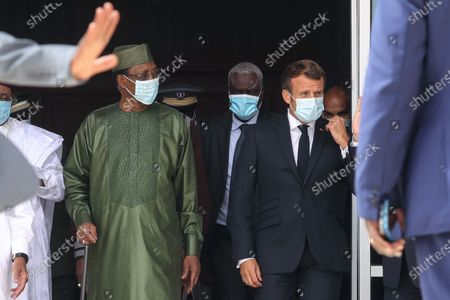 Chadian President Idriss Deby (L), Chairman of the African Union Commission Moussa Faki Mahamat (C) and French President Emmanuel Macron (R) wear face masks as they arrive for a group photo during the G5 Sahel Summit in Nouakchott, Mauritania, 30 June 2020. The leaders of the G5 Sahel West African countries and their ally France are meeting to confer over their troubled efforts to stem a jihadist offensive unfolding in the region, six months after rebooting their campaign in Pau, southwestern France.