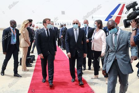 French President Emmanuel Macron (C-L) is welcomed by Mauritania President Mohamed Ould Ghazouani (C-R) upon arrival at Nouakchott-Oumtounsy International Airport, in Nouakchott, Mauritania, 30 June 2020, to attend a G5 Sahel summit. The leaders of the G5 Sahel West African countries and their ally France are meeting to confer over their troubled efforts to stem a jihadist offensive unfolding in the region, six months after rebooting their campaign in Pau, southwestern France.