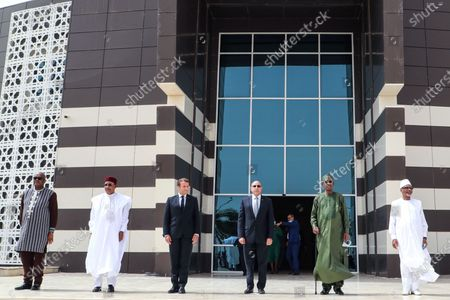 (L-R) Burkinabe President Roch Marc Kabore, Nigerien President Mahamadou Issoufou, French President Emmanuel Macron, Mauritanian President Mohamed Ould Ghazouani, Chadian President Idriss Deby and Malian President Ibrahim Boubacar Keita pose for a group picture during the G5 Sahel Summit in Nouakchott, Mauritania, 30 June 2020. The leaders of the G5 Sahel West African countries and their ally France are meeting to confer over their troubled efforts to stem a jihadist offensive unfolding in the region, six months after rebooting their campaign in Pau, southwestern France.