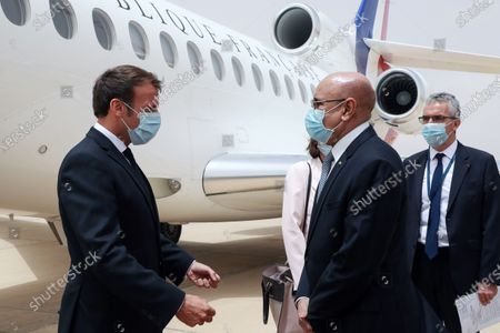 French President Emmanuel Macron (L) is welcomed by Mauritanian President Mohamed Ould Ghazouani (2-R) upon arrival at Nouakchott-Oumtounsy International Airport, in Nouakchott, Mauritania, 30 June 2020, to attend a G5 Sahel summit. The leaders of the G5 Sahel West African countries and their ally France are meeting to confer over their troubled efforts to stem a jihadist offensive unfolding in the region, six months after rebooting their campaign in Pau, southwestern France.