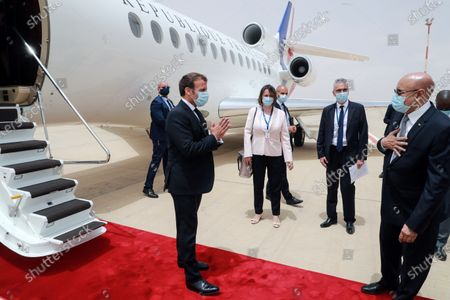 French President Emmanuel Macron (L) is welcomed by Mauritania President Mohamed Ould Ghazouani (R) upon arrival at Nouakchott-Oumtounsy International Airport, in Nouakchott, Mauritania, 30 June 2020, to attend a G5 Sahel summit. The leaders of the G5 Sahel West African countries and their ally France are meeting to confer over their troubled efforts to stem a jihadist offensive unfolding in the region, six months after rebooting their campaign in Pau, southwestern France.