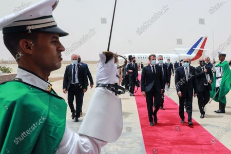 French President Emmanuel Macron (C) is welcomed by Mauritania President Mohamed Ould Ghazouani (3-R) upon arrival at Nouakchott-Oumtounsy International Airport, in Nouakchott, Mauritania, 30 June 2020, to attend a G5 Sahel summit. The leaders of the G5 Sahel West African countries and their ally France are meeting to confer over their troubled efforts to stem a jihadist offensive unfolding in the region, six months after rebooting their campaign in Pau, southwestern France.