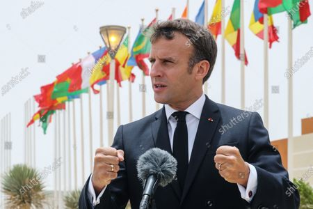 French President Emmanuel Macron speaks to the press upon his arrival at Nouakchott-Oumtounsy International Airport, in Nouakchott, Mauritania, 30 June 2020, to attend a G5 Sahel summit. The leaders of the G5 Sahel West African countries and their ally France are meeting to confer over their troubled efforts to stem a jihadist offensive unfolding in the region, six months after rebooting their campaign in Pau, southwestern France.