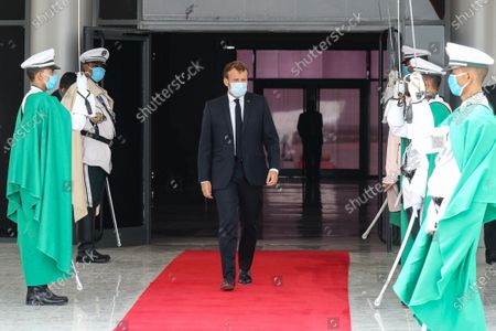 French President Emmanuel Macron (C) wears a face mask as he walks past a guard of honor after arriving at Nouakchott-Oumtounsy International Airport, in Nouakchott, Mauritania, 30 June 2020, to attend a G5 Sahel summit. The leaders of the G5 Sahel West African countries and their ally France are meeting to confer over their troubled efforts to stem a jihadist offensive unfolding in the region, six months after rebooting their campaign in Pau, southwestern France.