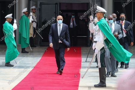 Mauritanian President Mohamed Ould Ghazouani (C) wears a face mask as he walks past a guard of honor to welcome the French president upon his arrival at Nouakchott-Oumtounsy International Airport, in Nouakchott, Mauritania, 30 June 2020, to attend a G5 Sahel summit. The leaders of the G5 Sahel West African countries and their ally France are meeting to confer over their troubled efforts to stem a jihadist offensive unfolding in the region, six months after rebooting their campaign in Pau, southwestern France.