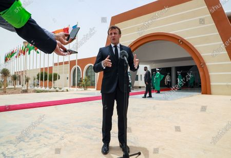 Stock Photo of French President Emmanuel Macron speaks to the press upon his arrival at Nouakchott-Oumtounsy International Airport, in Nouakchott, Mauritania, 30 June 2020, to attend a G5 Sahel summit. The leaders of the G5 Sahel West African countries and their ally France are meeting to confer over their troubled efforts to stem a jihadist offensive unfolding in the region, six months after rebooting their campaign in Pau, southwestern France.