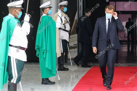 French President Emmanuel Macron (R) wears a face mask as he walks past a guard of honor after arriving at Nouakchott-Oumtounsy International Airport, in Nouakchott, Mauritania, 30 June 2020, to attend a G5 Sahel summit. The leaders of the G5 Sahel West African countries and their ally France are meeting to confer over their troubled efforts to stem a jihadist offensive unfolding in the region, six months after rebooting their campaign in Pau, southwestern France.