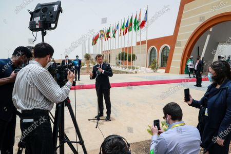 French President Emmanuel Macron (C) speaks to the press upon his arrival at Nouakchott-Oumtounsy International Airport, in Nouakchott, Mauritania, 30 June 2020, to attend a G5 Sahel summit. The leaders of the G5 Sahel West African countries and their ally France are meeting to confer over their troubled efforts to stem a jihadist offensive unfolding in the region, six months after rebooting their campaign in Pau, southwestern France.