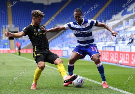 Madejski Stadium, Reading, Berkshire, England; Jordan Obita of Reading holds off Emiliano Marcondes of Brentford with a straight arm; English Championship Football, Reading versus Brentford.