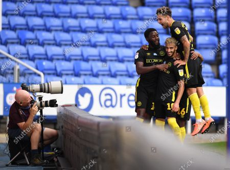 Madejski Stadium, Reading, Berkshire, England; Josh Dasilva of Brentford celebrates with his team in front of the club photographer after scoring in 65th minute for 0; English Championship Football, Reading versus Brentford.