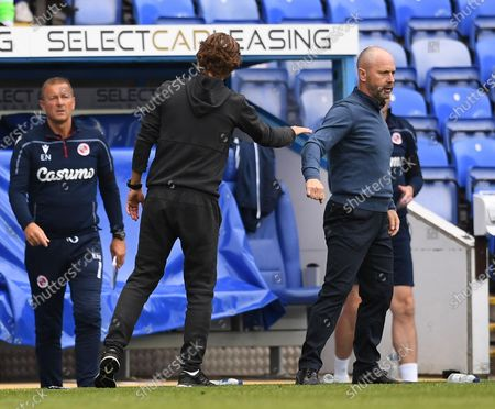 Madejski Stadium, Reading, Berkshire, England; Thomas Frank Manager of Brentford and Mark Bowen Manager of Reading bump hands after the match; English Championship Football, Reading versus Brentford.