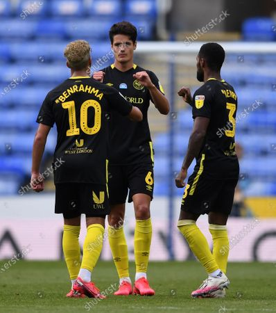 Stock Picture of Madejski Stadium, Reading, Berkshire, England; Saïd Benrahma, Christian Norgaard and Rico Henry of Brentford bump hands after the match; English Championship Football, Reading versus Brentford.