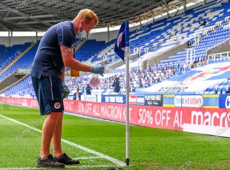 Madejski Stadium, Reading, Berkshire, England; the corner flag is disinfected at Madejeski stadium before kick off; English Championship Football, Reading versus Brentford.
