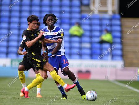 Madejski Stadium, Reading, Berkshire, England; Christian Norgaard of Brentford tackles Ovie Ejaria of Reading; English Championship Football, Reading versus Brentford.
