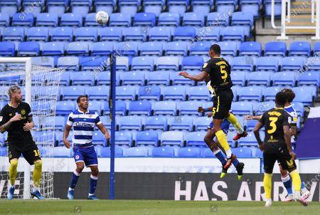 Madejski Stadium, Reading, Berkshire, England; Ethan Pinnock of Brentford heads the ball towards goal and Bryan Mbeumo scores in 22nd minute 0; English Championship Football, Reading versus Brentford.