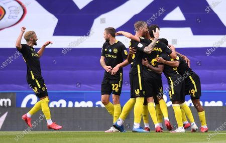 Madejski Stadium, Reading, Berkshire, England; Bryan Mbeumo of Brentford celebrates with his team after scoring in 22nd minute 0; English Championship Football, Reading versus Brentford.