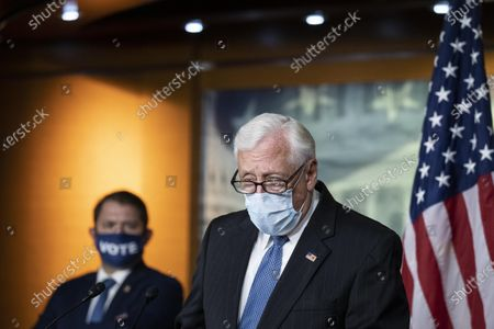 House Majority Leader Steny Hoyer of Md., right, accompanied by Rep. Ruben Gallego, D-Ariz., speaks with reporters during a news conference on Capitol Hill after a meeting at the White House, in Washington