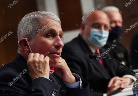 Dr. Anthony Fauci, director of the National Institute for Allergy and Infectious Diseases, CDC Director Dr. Robert Redfield and Adm. Brett Giroir, director of the U.S. coronavirus diagnostic testing, (L to R), testify before the Senate Health, Education, Labor and Pensions (HELP) Committee on Capitol Hill in Washington DC. Government health officials updated the Senate on how to safely get back to school and the workplace during the COVID-19 pandemic.